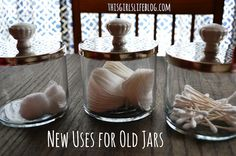 upcycled apothecary jars. Reuse old glass candle jars for guest bathroom.