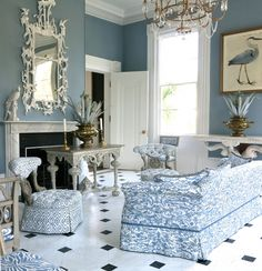 Pretty blue  white room in Carolyne Roehm's Charleston home. This is her bird room, it all started with a beautiful bird painting.