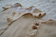 tea die onesies and embellish with lace!  So sweeeeeet!