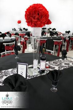 Black white and red wedding with tall centerpiece, red flower ball, red pomander