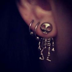 Skeleton earrings...very cute; it shouldn't be, but I think it's awesome. I would wear it.
