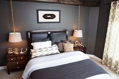 love the light hanging from the ceiling - saves valuable real estate on the night stand.