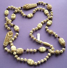 White glass beads Egyptian Revival necklace.  Photograph Gillian Horsup.