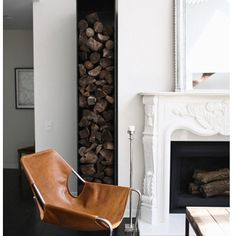 SnapWidget | What a great space by Catherine Kwong Desig based in SF! I love the leather chair and the wood stacked! #interiordesign #leatherchair