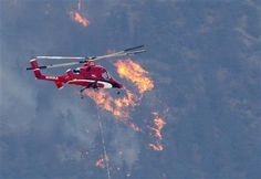 A firefighting helicopter approaches the Waldo Canyon fire in Colorado