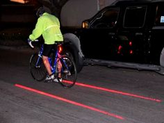 The Bicycle Rear Laser Tail Light has two laser lights that emit two parallel lines forming your very own personal virtual bike lane on the road.