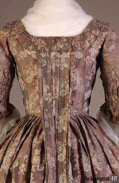 Detail back view, robe à la francaise, Denmark, c. 1760. Violet and pink iridescent silk brocade with floral sprays.
