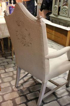 Painted Chair | Fabric painted in a 50/50 mix of French Linen and Old White Chalk Paint® decorative paint by Annie Sloan. The stencil was painted in French Linen with the wood frame painted with Paris Grey Chalk Paint®  with both clear and dark wax. Project by Maison Decor.