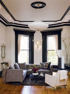 Bold black paint makes the home's architectural bones really stand out.