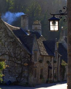 Quaint stone cottages in an English village.  Love the lantern and the smoke in the chimney!!
