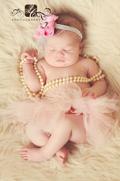 Baby Girl with her Tutu and Pearls