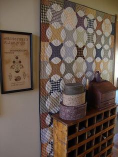 Prim Quilt Display...old cubby with boxes.