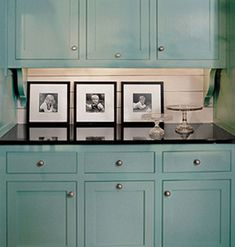 Love the colored cabinets