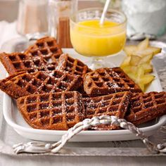 Gingerbread Waffles with Hot Lemon Curd Sauce: Drench these spicy-sweet waffles in our zingy lemon sauce.  More brunch recipes: http://www.midwestliving.com/food/breakfast/25-festive-brunch-recipes/page/3/0 christmas morning breakfast, hot lemon, lemons, lemon curd, food, gingerbread waffl, waffles, sauc, holiday recipes