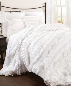 Gorgeous white ruffled bedding