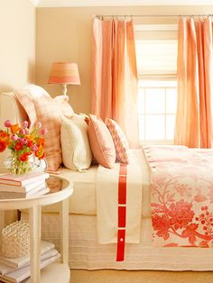 The warm color palette in this enchanting bedroom begins with the walls. Paint in a deep, dusty taupe with whispers of rose creates a feeling of intimacy, while salmon-color silk taffeta draperies define the window and add sheen. A floral duvet on the bed blushes in shades of pink that are echoed in the painted lampshade. coral, color palettes, warm colors, orang, guest bedrooms, color schemes, ribbon, peach, guest rooms