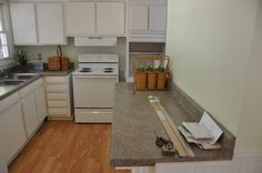 Cheap kitchen redo at my dad's house.  I used bead board panels to resurface the cabinets and stock countertops.