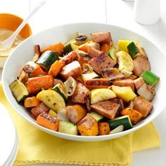 Roasted Kielbasa & Vegetable main dish.  I have seriously made this about 5x this summer. It's so easy, healthy and delicious! (Carrots, Zucchini, Squash, Onion, Sweet Potatoes and Kielbasa - toss with olive oil and roast!)