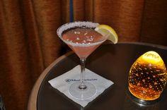 Ingredients: 1.5 oz Vodka 0.5 oz Monin Passion Fruit Syrup 0.75 oz Cranberry Juice 1 Lemon Wedge  Glass: Martini Glass  Garnish: Sprinkles of Coco