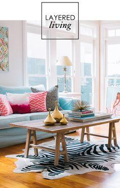 Coffee table styling..  adore home magazine aqua blue sofa zebra rug living room layered eclectic coastal