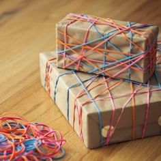 Colorful and shiny office supplies become fun holiday gift wrap. This would be a great way to include younger children in gift wraping.
