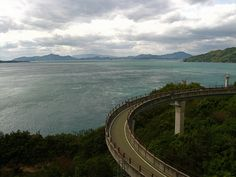 Shimanami Kaido    That's a ramp. For bikes. A massive ramp for bikes, and it's only a tiny part of just one of the many such ramps on this route. The amount of money and planning and design and materials and effort that went into this bike route is pretty amazing and although I am not complaining, I have absolutely no idea why they would ever build something like this.