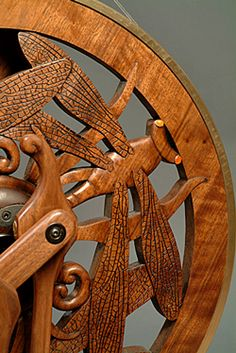 """""""Dragonfly Wheel"""" Triple Flyer, Hand carved Walnut Ultra High Speed (33:1) by Golding.       A spinner's love for dragonflies was the inspiration for the creation of this wheel. Carnelian gem stones were used for the dragonfly eyes.    $8,500"""