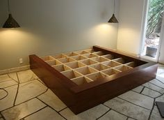 DIY bed platform with hidden storage for out of season clothes, shoes.