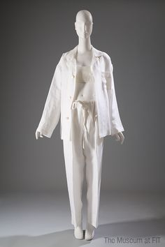 Erica Tanov, linen pajamas and bra, 1993. Collection of The Museum at FIT. #lingeriehistory / Erica Tanov launched her line of sleepwear in 1991. Many of her designs have been inspired by the simple, classic look of her grandfather's silk pajamas. The loosely fitted top and pants of this sleepwear ensemble are clearly based on the Tanov's interest in men's styles, but the sexy, bandeau bra is purely feminine.