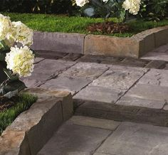 These 8-inch-high pieces provide an alternative for edging driveways, patios and walkways; they can also be used to form planter walls. An array of color choices is available, with each displaying a hand-hewn stone look that has been tumbled to look distressed. A number of different lengths are available to create a natural-looking flow. All pieces are beveled, which allows users to create straight and curved designs.