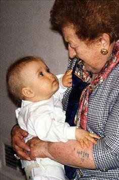 Holocaust survivor looking at her granddaughter.