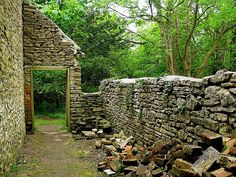 Tyneham, England - During World War II, the Ministry of Defense took over this town on the Isle of Purbeck in south England for use as an army base. Citizens were promised their homes back after the war ended, but were never allowed back in. It has stood as ghost village ever since, lying in ruins.