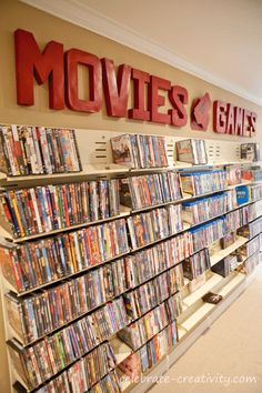 Theatre room - Movie and game wall >>> THE DREAM. One day when I somehow acquire lots of money, I will have a theater room that looks like movie rental store.
