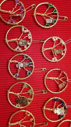 Get the owl charms from a craft store and the circles in the sewing section.
