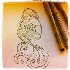 a different sort of mermaid tattoo - very cute!