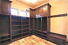 Mudroom open lockers with shoe racks.