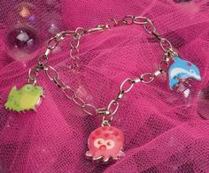 Kids Charm Bracelet - Dolphin, Octopus, Frog at theBIGzoo.com, a toy store with over 12,000 products.