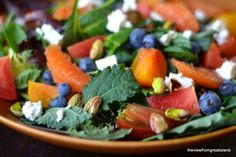 Super Salad with a Wonderful Blood Orange Dressing. Yum, blueberries, tomato's, pistachios, pomegranate seeds, citrus, and feta, with baby greens.