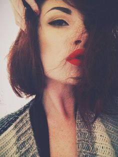 Cat eyes and red lips.