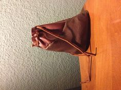 Leather coin pouch.