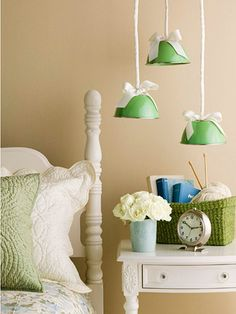 Hanging Bowl Lamps///Hanging Bowl Lamps  We see plenty of pendant lamps in kitchen spaces, but this charming twist makes them bedroom-ready. Simply drill a hole in the bottom of an enamelware bowl, invert, and insert a halogen accent light, securing with caulk. To dress up the cord, fold 1-inch grosgrain ribbon around it and glue with fabric adhesive, forming an inverted seam. Finish with a bow.