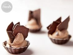 Mini Chocolate Mousse Cups _ Sweet chocolate mousse swirled into a mini chocolate cup makes Freed's Mini Chocolate Mousse Cups the perfect pastry bite. Topped with shaved chocolate, it's just the treat to satisfy your craving.