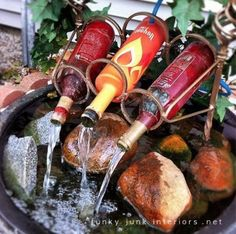reuse wine bottles for a diy fountain...would be great if there was a light making the water look like wine recycled garden, craft, garden ideas, water gardens, backyard, wine bottles, garden water features, garden fountains, yard ideas