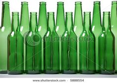 Empty green beer bottles make fun vases for your St. Patrick's Day table.