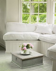 Beautiful vintage piece used as a low table - love the bench cushions .. cozy and inviting for breezeway window area