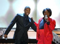 """Usher and James Brown went head-to-head (and toe-to-toe) in a dance-off as the pair teamed to perform """"Caught Up"""" and """"Sex Machine"""" at the 47th GRAMMY Awards in 2005"""