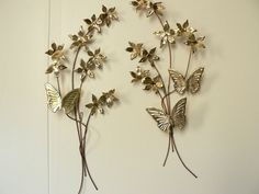 Take some vintage wall decorations (like these) and use them to hang pictures. Spray white if you'd like.