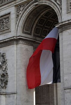 French flag  flying from the Arc de Triomphe