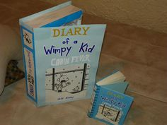 Diary of a Wimpy Kid Valentines box...just made it out of a shirt box & some posterboard.-- change it to book 7's cover for 2013 :) Good idea..too bad it doesn't tell how to make it.