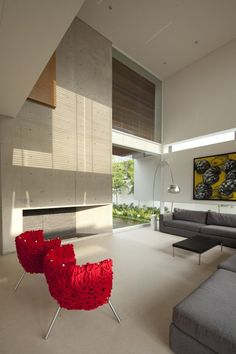 Red Chairs!!  FF House / Hernandez Silva Arquitectos